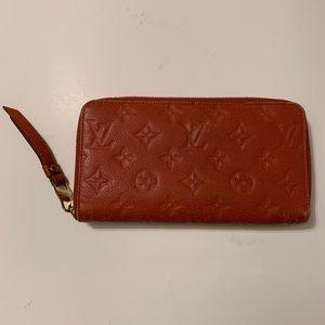 LV Iris Zippy Wallet